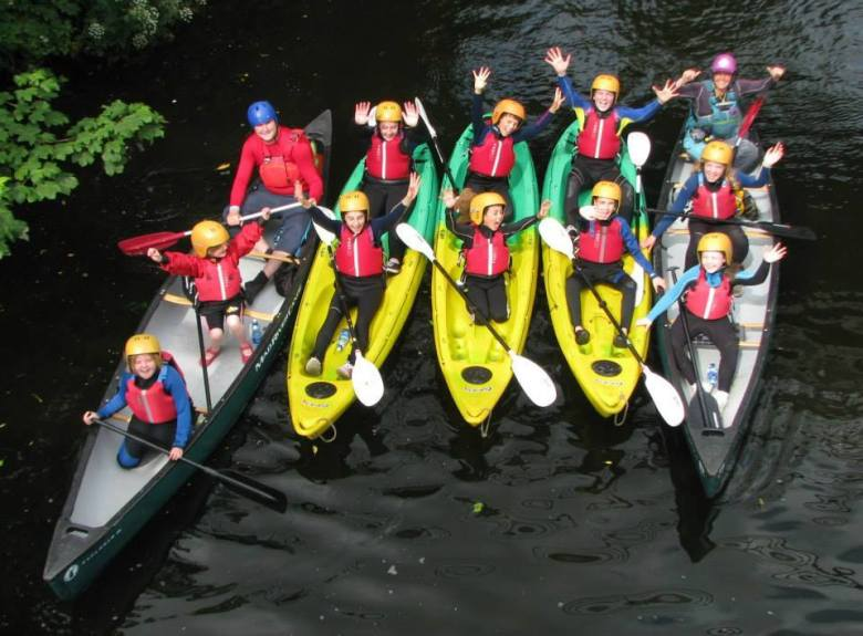 Children kayaking and canoeing on the Slaney